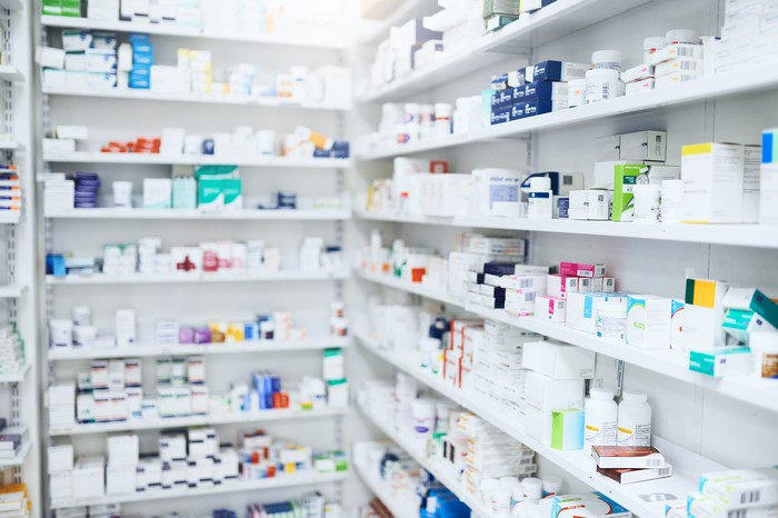 Medical products on shelves in a pharmacy.