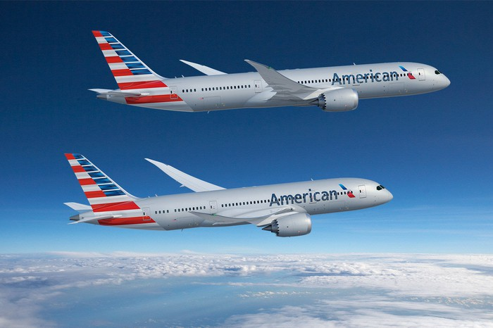 A Boeing 787-8 and a Boeing 787-9 flying in the American Airlines livery