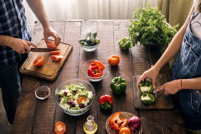 A couple prepares fresh food.