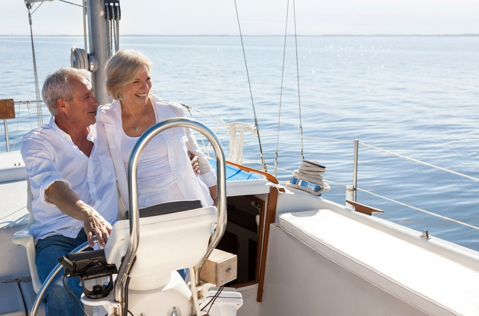Older man and woman on a boat out on the water