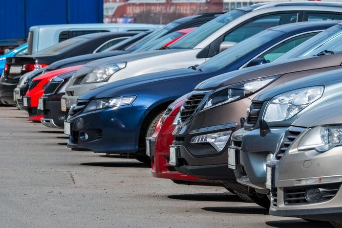 Cars on a dealership lot.