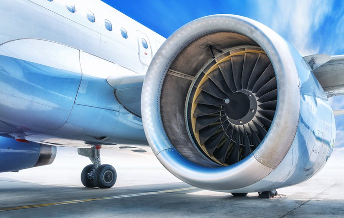 close up of jet engine on wing of aircraft