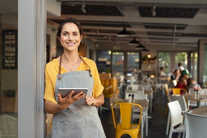 Restaurant worker holding a tablet