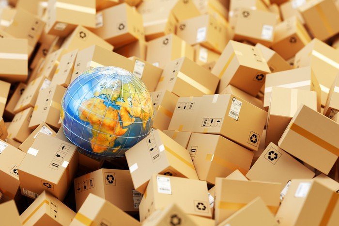 A globe surrounded by cardboard packages