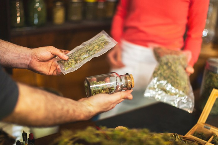 A person buys cannabis at a dispensary