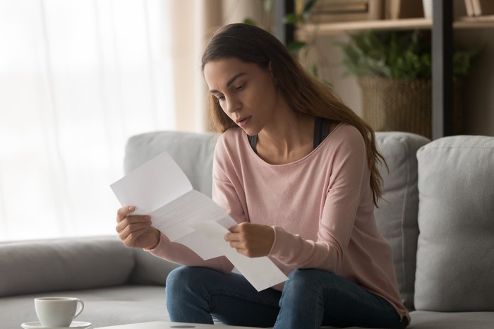 Woman reading a letter.