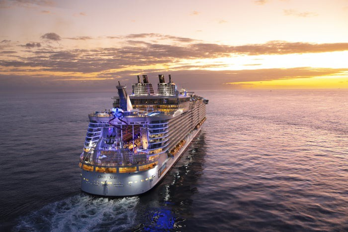 A Royal Caribbean ship on the water.