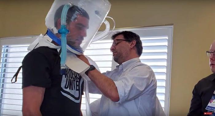 Doctor testing an oxygen hood prototype