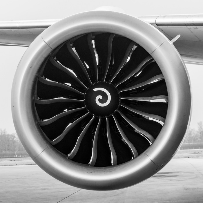 A General Electric GEnx-1B jet engine attached to an airplane wing