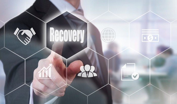 """Finger pointing to a hexagon that says, """"Recovery"""""""