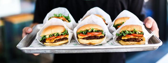A tray of Shake Shack burgers.