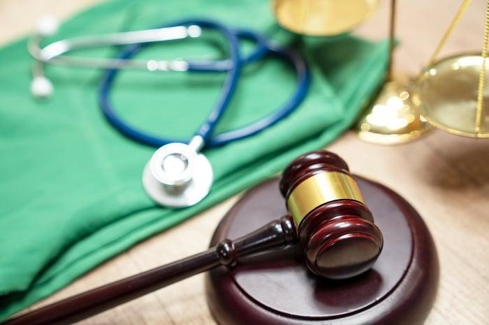 judges gavel and medical equipment representing medical lawsuit
