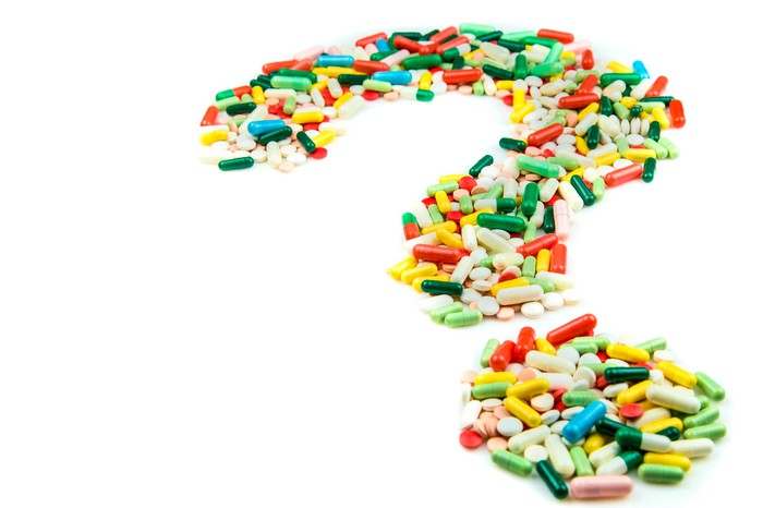 Pills forming a question mark
