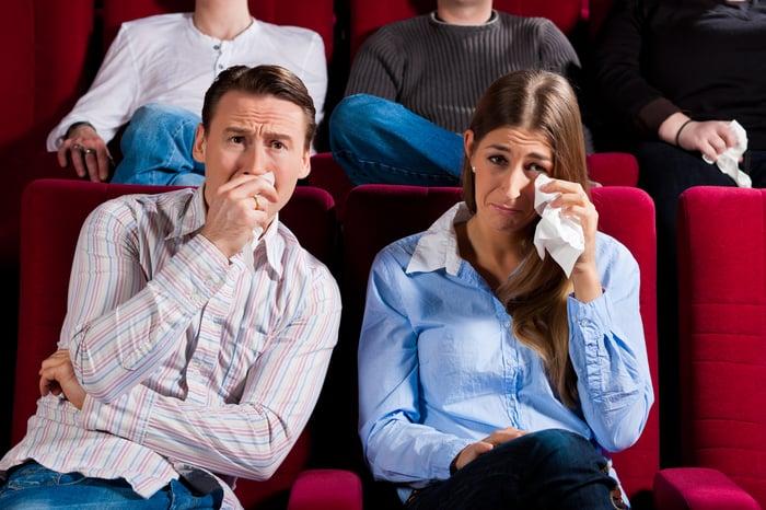 Couple feeling sad at a theater