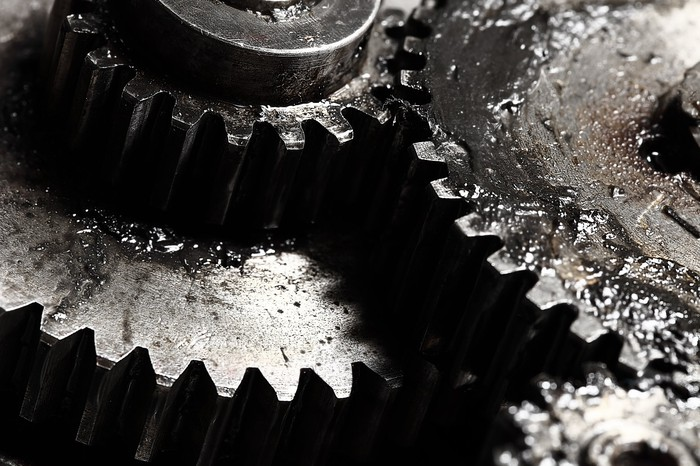 Close-up of four greasy gears