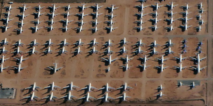 aerial view of many passenger planes parked