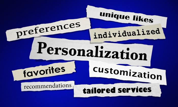 "Newsprint clippings of words such as ""personalization,"" ""individualized,"" and ""favorites"""
