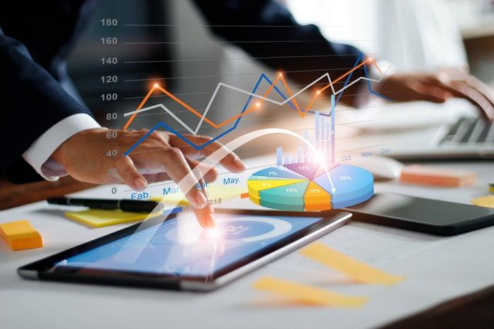 Business analyst examining data