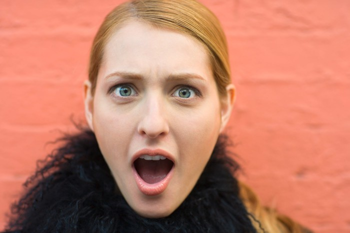 Young woman with shocked expression.