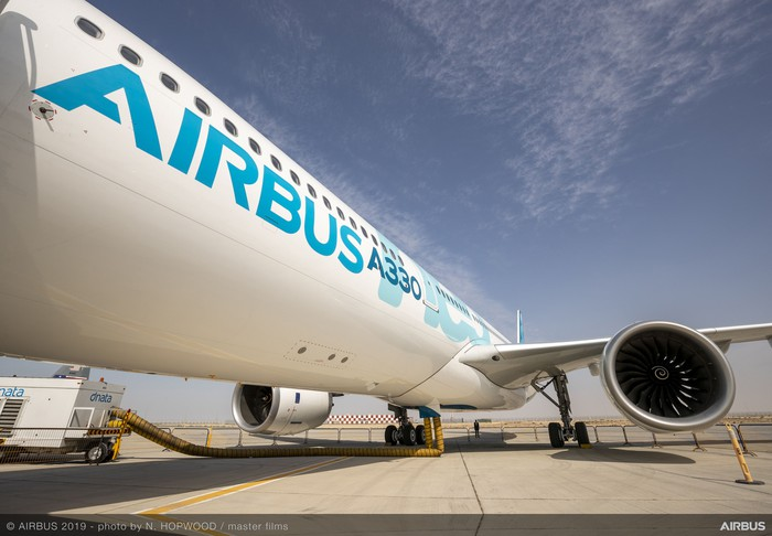 An Airbus A330neo parked on the tarmac.