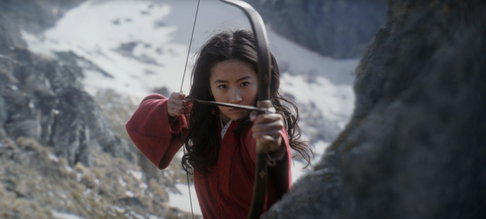 An image from the live action version of the Disney movie Mulan shows Mulan about the fire an arrow from a bow