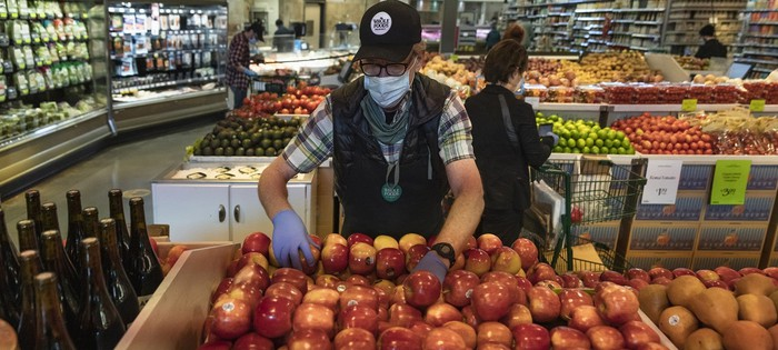 Whole Foods employees picking online orders