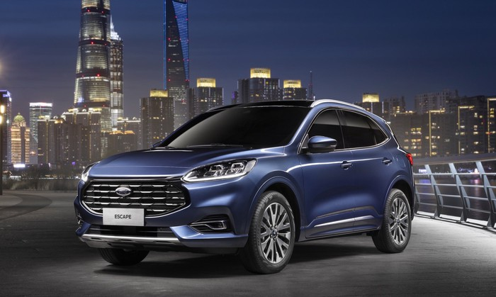 A Chinese-market 2020 Ford Escape, a compact crossover SUV, with a city skyline in the background.