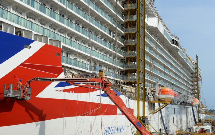 A view of workers refreshing the paint on a Carnival ship.