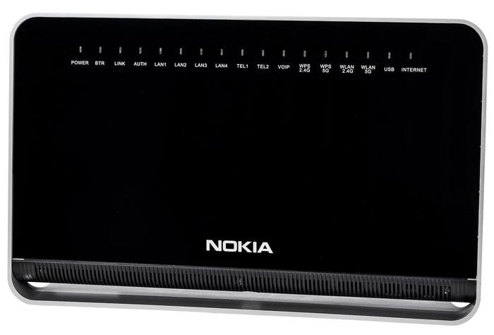 Black rectangular piece of networking equipment with Nokia logo.