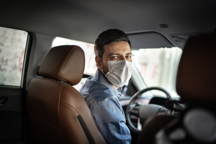 Uber driver wearing a mask in the car.