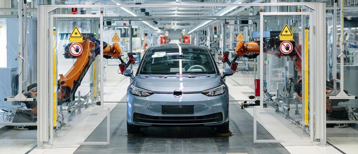 Robots attend to a VW ID.3 hatchback on the production line at VW's Zwickau factory.
