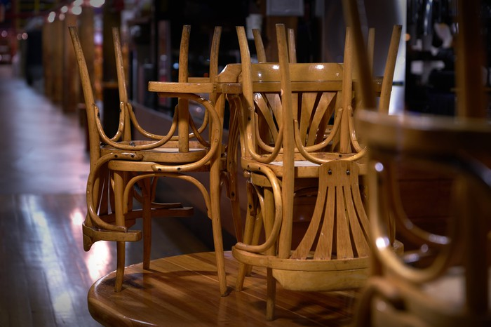 An empty restaurant with chairs stacked.