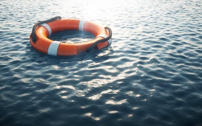 Life preserver floating on empty ocean water.