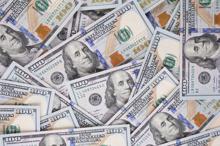 Loose pile of hundred-dollar bills