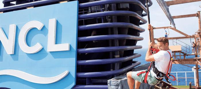 A passenger on a rock wall atop a Norwegian Cruise Line ship.