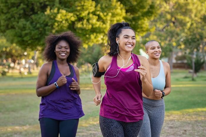 Three ladies jogging in a park