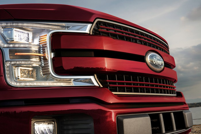 The grill and front end of a red 2020 Ford F-150, a full-size pickup truck.