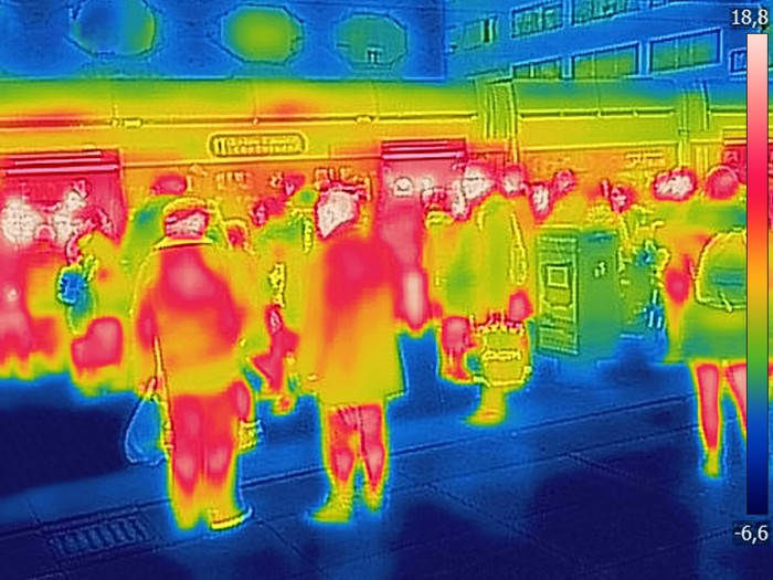 Infrared images of a crowd of people at a train station.