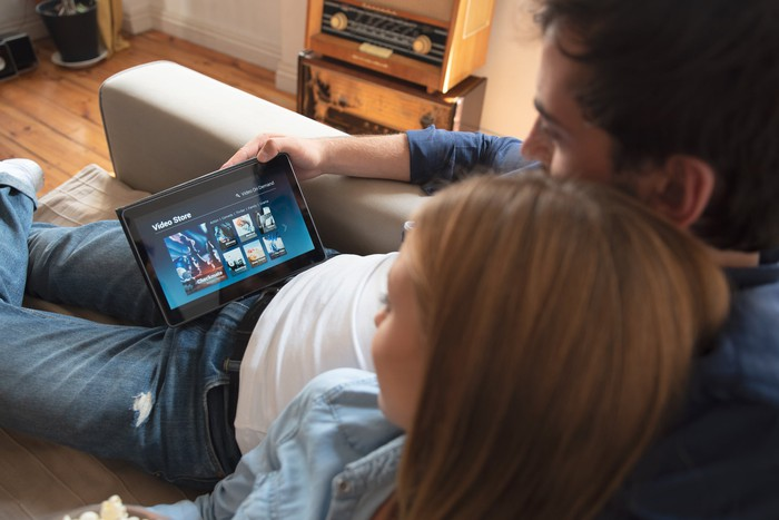 A couple streaming movies on a tablet.