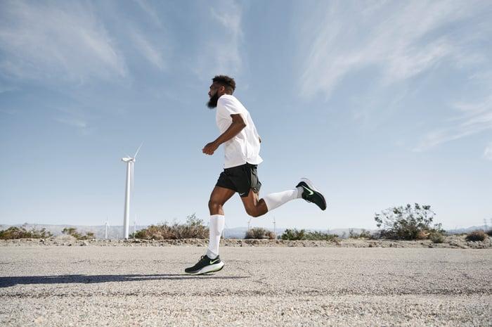 Man running in Nike sneakers.