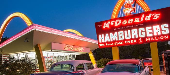 McDonalds parking lot with vintage cars.