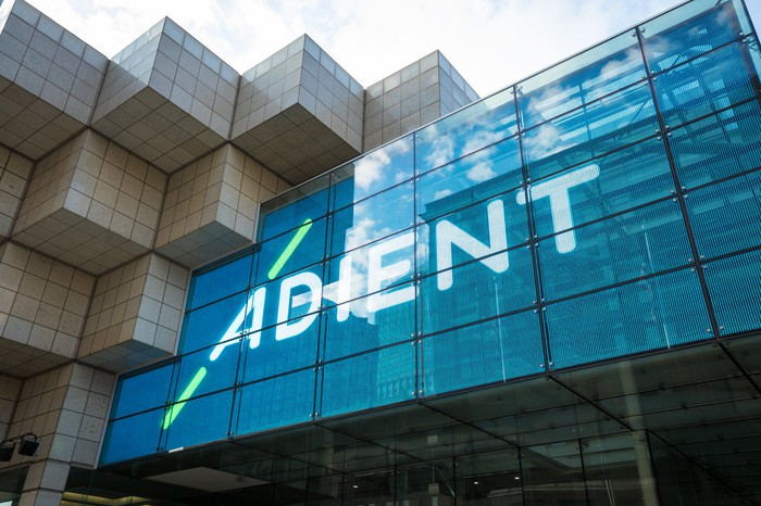 Adient's logo appears on the outside of a convention center in Detroit.