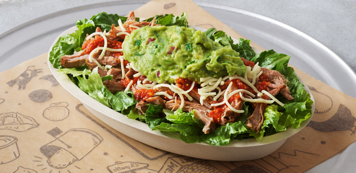 A burrito bowl from Chipotle sitting on a metal tray.