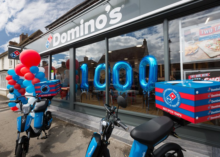 A Domino's store with balloons.