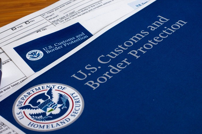 Immigration forms labeled U.S. Customs and Border Protection.