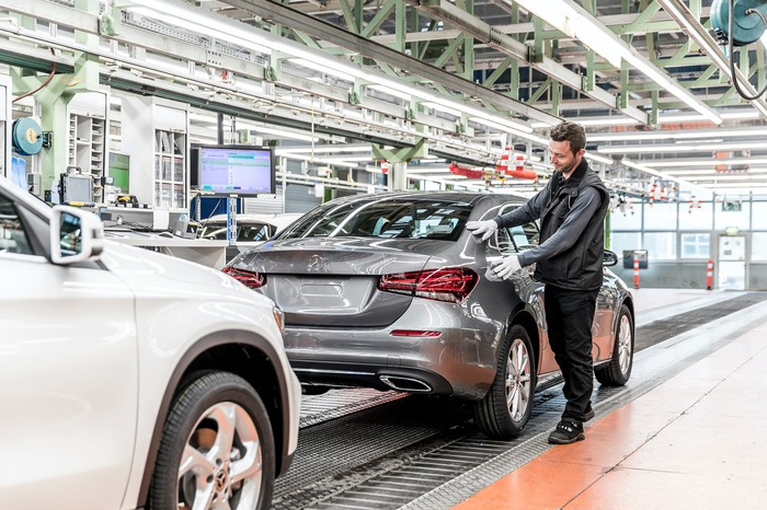 A worker tends to a Mercedes-Benz sedan on the production line at Daimler's factory in Rastatt, Germany.