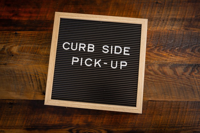 A curbside pickup sign.