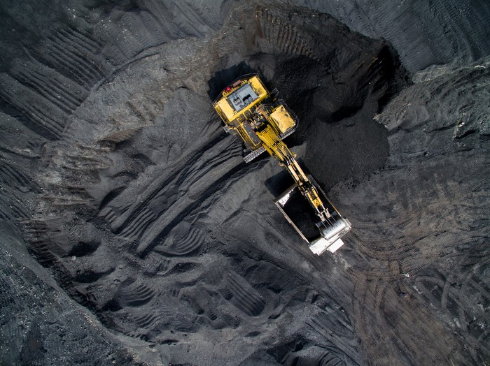 Overhead shot of excavating equipment at a coal mine.