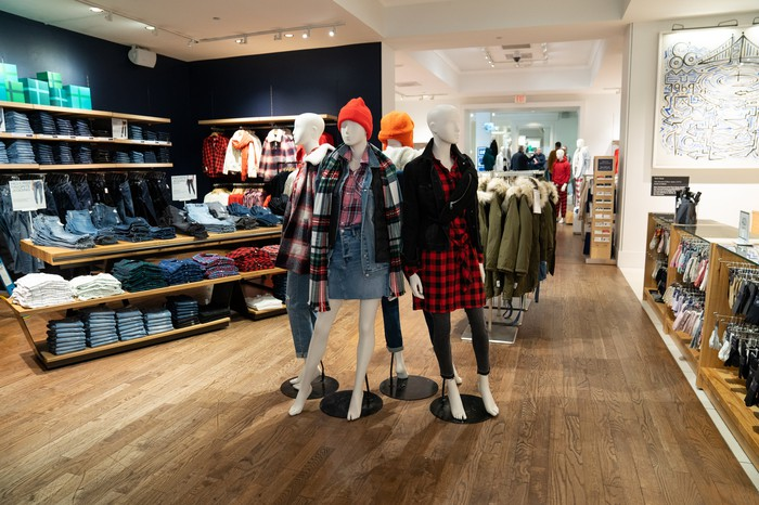 The interior of a Gap store with mannequins and clothes on display.