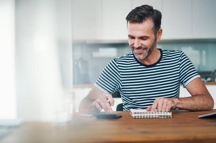 Man doing calculations
